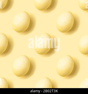 Pastel yellow eggs isometric seamless pattern. Monochrome Easter holiday concept. Modern minimal food photography collage. Top view, flat lay - Stock Photo