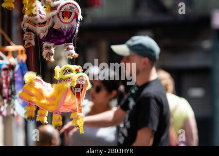New York City, USA - June 21, 2019: Traditional chinese souvenirs for sale at a shop at Chinatown - Stock Photo