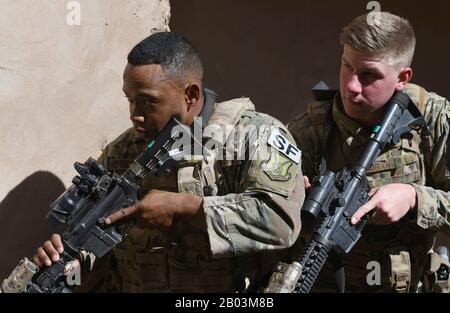 U.S. Air Force Staff Sgt. Noel Cheeseboro, left, and Airman 1st Class Ian Moran, 409th Expeditionary Security Forces Squadron Response Force team members, conduct building clearing procedures during a close quarters battle refresher course at Nigerian Air Base 201 February 5, 2020 in Agadez, Niger. - Stock Photo