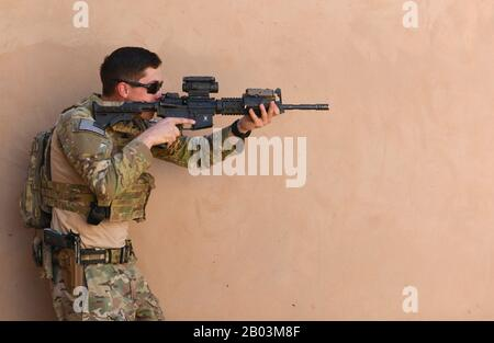 U.S. Air Force Senior Airman Steven Chaney, 409th Expeditionary Security Forces Squadron Response Force, conducts building clearing procedures during a close quarters battle refresher course at Nigerian Air Base 201 February 5, 2020 in Agadez, Niger. - Stock Photo