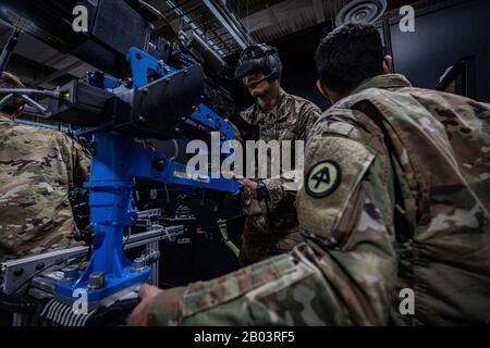 U.S. Army soldiers with the New Jersey National Guard Air Assault Infantry Regiment trains with a heavy weapons Virtual Reality simulator at the Regional Battle Simulation Training Center on Joint Base McGuire-Dix-Lakehurst February 8, 2020 in Lakehurst, New Jersey. - Stock Photo