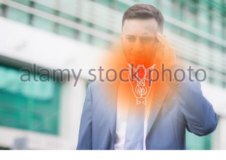 mature caucasian businessman in office suit suffering from pain in throat and nose, coronavirus symptoms or covid-19 - Stock Photo