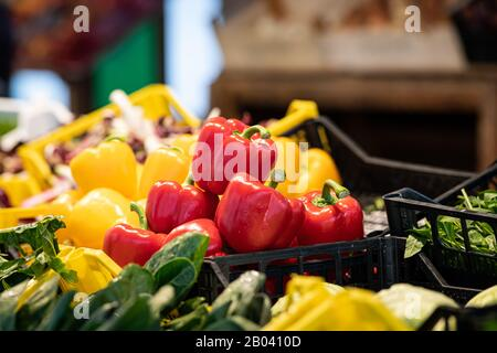 Fresh red and yellow pepper in a basket, market in Venice (Italy) - Stock Photo