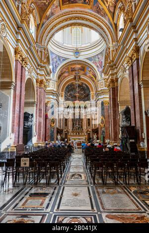 Metropolitan Cathedral of Saint Paul interior in city of Mdina, Malta, 17th-18th century Baroque landmark - Stock Photo