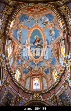 Malta, city of Mdina, Carmelite Church interior - Church of the Annunciation, spectacular elliptical ceiling with paintings, 17th century Baroque land - Stock Photo