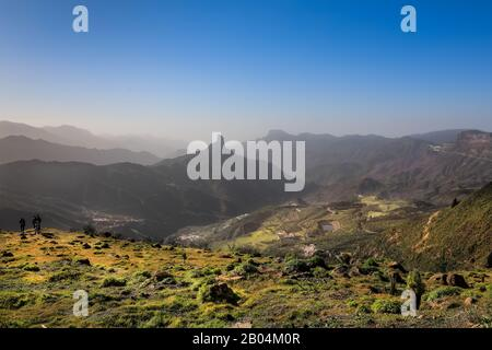 Panoramic view across the mountains and forest from Mirador de Degollada Becerra to Roque Bentayga in Parque Rural del Nublo Park, Gran Canaria - Stock Photo