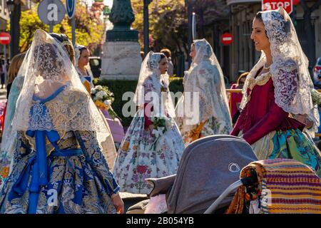Valencia, Spain, March 18, 2019. Valencian Festival of Fallas. Festive procession in the center of the city. Women Falleras  of Valencia. - Stock Photo