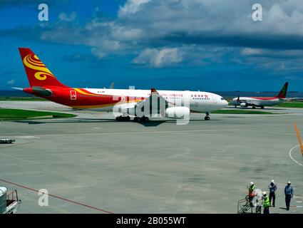 Hong Kong Airlines, Airbus, A330-200, B-LHB, Taxi to Gate, Naha International Airport, Naha, Okinawa, Ryukyu Islands Japan - Stock Photo