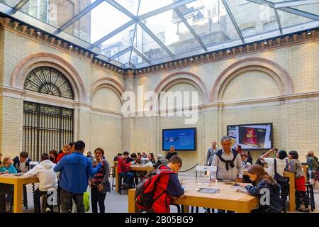 London, JUL 16: Interior view of The Apple Store in Covent Garden on JUL 16, 2011 at London - Stock Photo