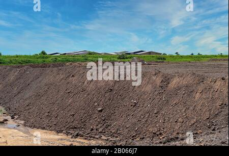 Mounds of dirt moved to create a stockpile within a housing development subdivision - Stock Photo
