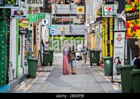 An indonesian couple tourists posing for a selfie picture on the street scenes of Haji Lane, Singapore.