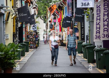 2 caucasian travellers strolling along the quiet street of Haji Lane in the morning. Singapore