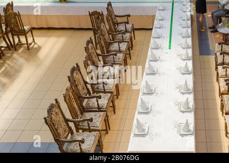 Aerial view to the long served table - Stock Photo