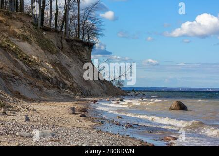 The Brodtener Ufer on the Baltic Sea near Lübeck Travemünde. The natural beach is a paradise for stone collectors. - Stock Photo