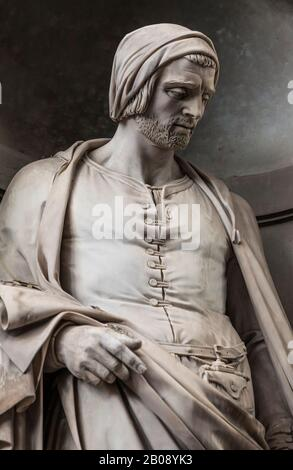 A statue of Nicola Pisano outside the Uffizi Gallery in Florence, Italy. Pisano is sometimes called the  founder of modern sculpture. - Stock Photo