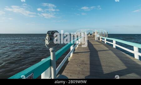 PINE ISLAND, FLORIDA - JAN 17, 2020. Old weathered telescopic viewer on Bokeelia Pier. - Stock Photo