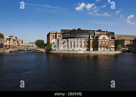 The Parliament House (Swedish: Riksdagshuset), is the seat of the parliament of Sweden, the Riksdag. It is located on nearly half of Helgeandsholmen (island), in the Gamla stan (old town) district of central Stockholm. Photo Jeppe Gustafsson - Stock Photo
