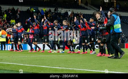 London, UK. 19th Feb, 2020. RB Leipzig's players acknowledge their supporters after the UEFA Champions League round of 16 1st leg match between Tottenham Hotspur and RB Leipzig at Tottenham Hotspur Stadium in London, Britain on Feb. 19, 2020. Credit: Han Yan/Xinhua/Alamy Live News - Stock Photo