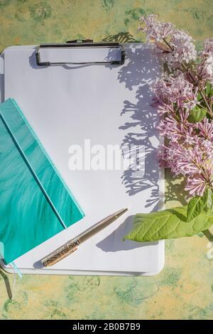 notebook mockup with lilac flowers, new goal. new year plan. fresh start, with goal setting.resolution. planner - Stock Photo