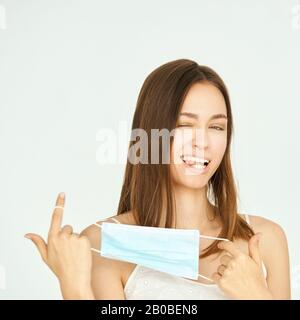 Pretty young woman with protective mask. Virus protection equipment. Anti smog person medic respiratory. Medical pollution. Coronavirus sick. - Stock Photo