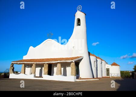 PORTO CERVO, ITALY - SEPTEMBER 21, 2017: A view of the Stella Maris Church in Porto Cervo, in Sardinia, Italy, built in the 1960s by the architect Mic - Stock Photo