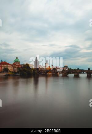 Charles bridge over Vltava River - Stock Photo