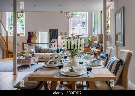Large table and bench in open plan dining area of 1830s chapel conversion