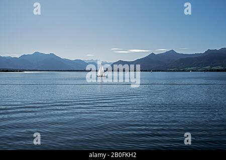 view over the chiemsee to the alps on a sunny summer day - Stock Photo