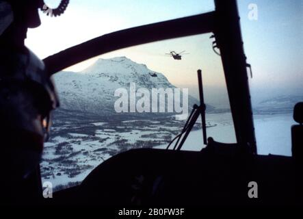 RAF Royal Air Force Puma helicopters flying over mountains at dusk during a NATO exercise near Tromso, Norway 1979. - Stock Photo