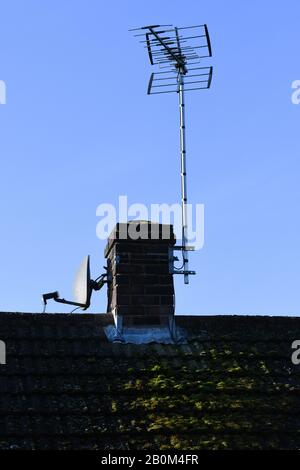 television aerials on the roof - Stock Photo