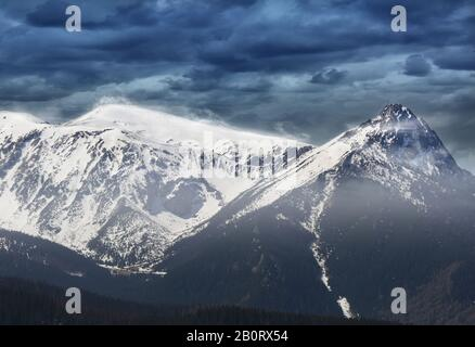 snow-capped peaks and a windy day in the Polish mountains - Stock Photo