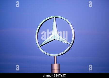 MILAN, ITALY - FEBRUARY, 2020: Official dealership logo of Mercedes-Benz. Mercedes-Benz is a German automobile industry. - Stock Photo