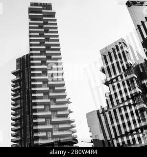 Abstract architectural background showing the Solaria Tower complex, Porta Nuova district in Milan, Italy. Geometric shapes and reflections.