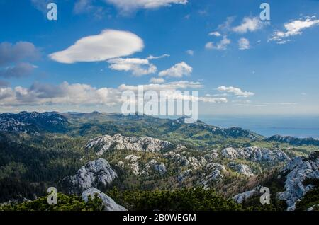 View of mountains, sky and sea in Croatia, Northern Velebit National Park. Scenic mountain landscape. Rocky mountains picturesque nature - Stock Photo