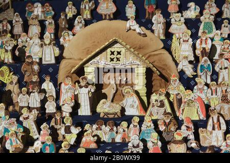 Traditional gingerbread nativity scene (perníkový betlém) on display in Saint Matthias Church (Kostel svatého Matěje) in Dejvice district in Prague, Czech Republic. Gingerbread figures of the nativity scene are baked annually in the church in the Christmas season. - Stock Photo
