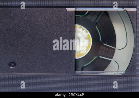 Stack of VHS video tapes as background. Old video cassette tapes. Retro technology. - Stock Photo