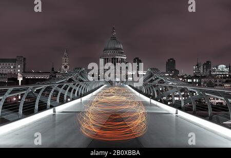 Light art, view of Millennium Bridge over the River Thames and St. Paul's - Cathedral at night, London, England, Great Britain,