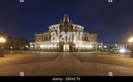Illuminated Semper Opera House on Theaterplatz, Dresden, Free State of Saxony, Germany, - Stock Photo