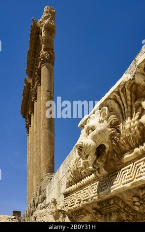 Pillars of the Temple of Jupiter and lion's head of the cornice in the ancient city of Baalbek, Lebanon, - Stock Photo