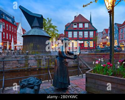 Plastic fish seller, wooden pedal crane and city scales at the old Hanseatic port of the Hanseatic city of Stade, Lower Saxony, Germany, - Stock Photo