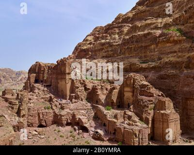 Rock wall at the outer Siq with tomb of Uneishu in the rock city of Petra, Jordan, Middle East, - Stock Photo