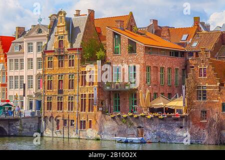 Ghent, Belgium old colorful traditional houses panorama along the canal and boats in popular touristic destination - Stock Photo
