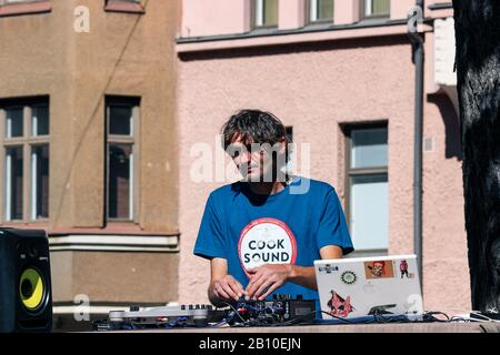 DJ playing records at Karhupuisto Park during pop-up restaurant day in Kallio district of Helsinki, Finland - Stock Photo