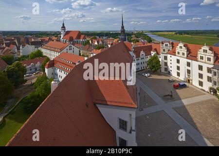 View over Castle Hartenfels to the town church St. Marien at the Elbe river in Torgau, Saxony, Germany - Stock Photo