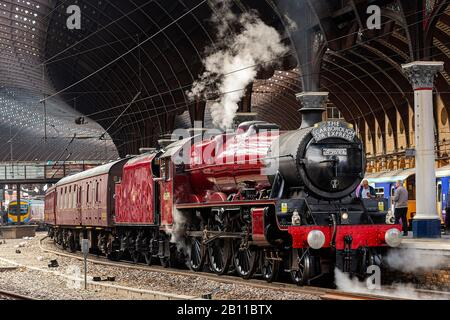 Steam Train excursion at York Station, North Yorshire. Headed by Galatea as it pulls into the platform on its way to Scarborough. - Stock Photo