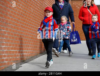 Selhurst Park, London, UK. 22nd Feb, 2020. English Premier League Football, Crystal Palace versus Newcastle United; Young Crystal Palace fan arriving at Selhurst Park Credit: Action Plus Sports/Alamy Live News - Stock Photo