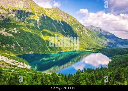 Morskie Oko lake (Eye of the Sea) at Tatra mountains in Poland. Famous Polish resort at Tatra National Park near Zakopane city. - Stock Photo