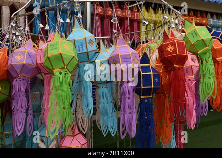 Display of colourful paper lanterns in the grounds of Wat Rong Seur Ten, otherwise known as the Blue Temple, Rim Kok, Chiang Rai Province, Thailand - Stock Photo