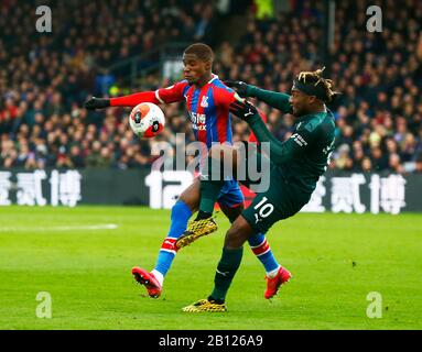 London, UK. 22nd Feb, 2020. L-R Crystal Palace's Wilfried Zaha and Newcastle United's Allan Saint-Maximin during English Premier League between Crystal Palace and Newcastle United at Selhurst Park Stadium, London, England on 22 February 2020 Credit: Action Foto Sport/Alamy Live News - Stock Photo