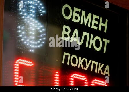 American dollar sign and the Russian inscription 'Currency exchange, purchase' on the board of the exchange office with the rates of convertible currencies in central Moscow, Russia - Stock Photo